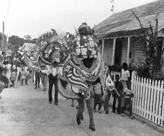 A Junkanoo Parade Winds Through New Plymouth During the First Island Roots Heritage Festival