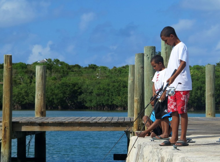 Summertime fishing from the public dock - Green Turtle Cay, Bahamas