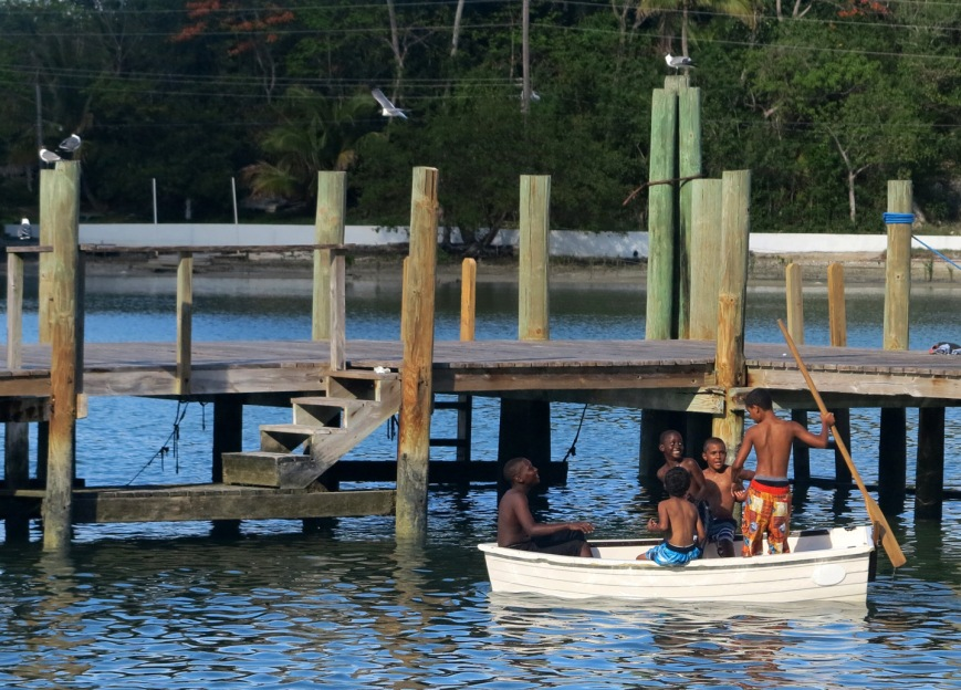 Local boys at play in Settlement Creek - Green Turtle Cay, Abaco, Bahamas.
