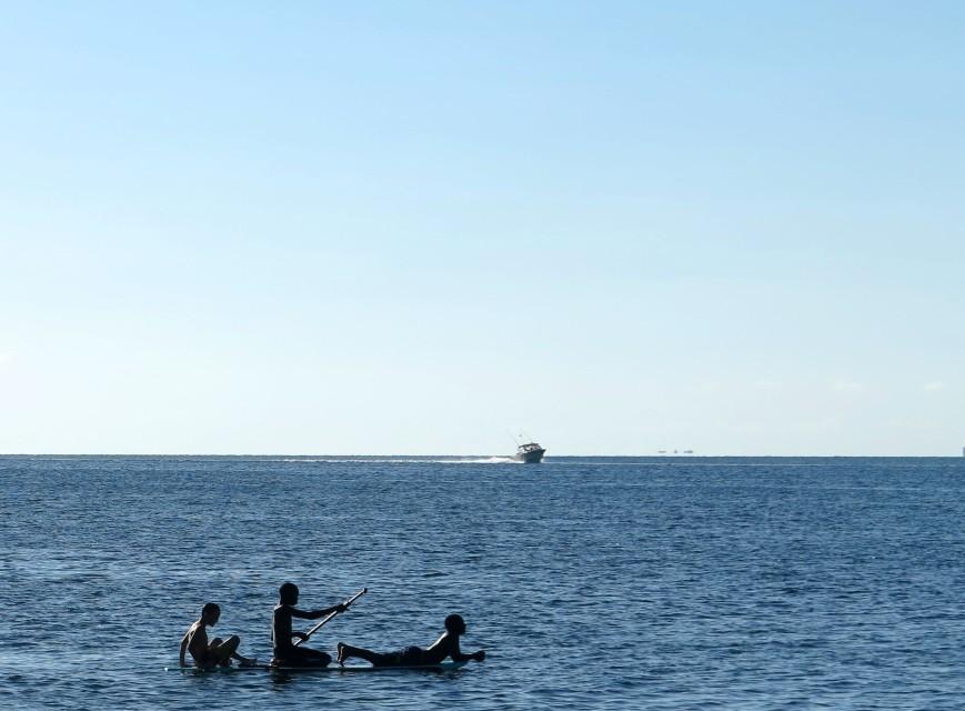 Boys on a paddleboard, Green Turtle Cay, Bahamas.