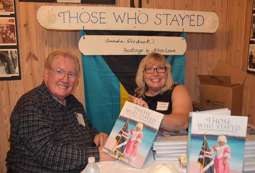 January 7, 2017 - Bluff House Beach Resort, GTC - Alton Lowe and Amanda Diedrick sign copies of Diedrick's recently published coffee table book, Those Who Stayed, at the book launch in Green Turtle Cay, Bahamas.