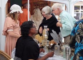 Volunteer Patricia McIntosh greets attendees